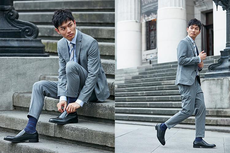 一名灰西裝男人在階梯上穿樂福鞋