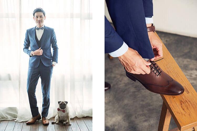 穿藍西裝配牛津鞋的男人與一隻狗