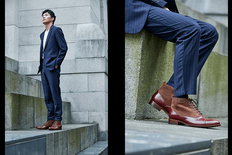 穿藍底白直條紋西裝的男人搭配酒紅色高筒皮底靴