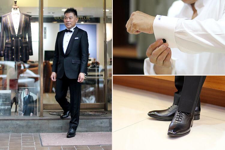 金興西服主理人邱文興穿黑西裝打黑領結示範黑色牛津鞋