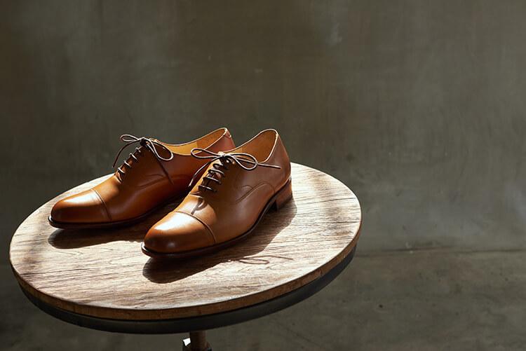 鵝頸橫飾皮底牛津鞋 蜜糖棕色